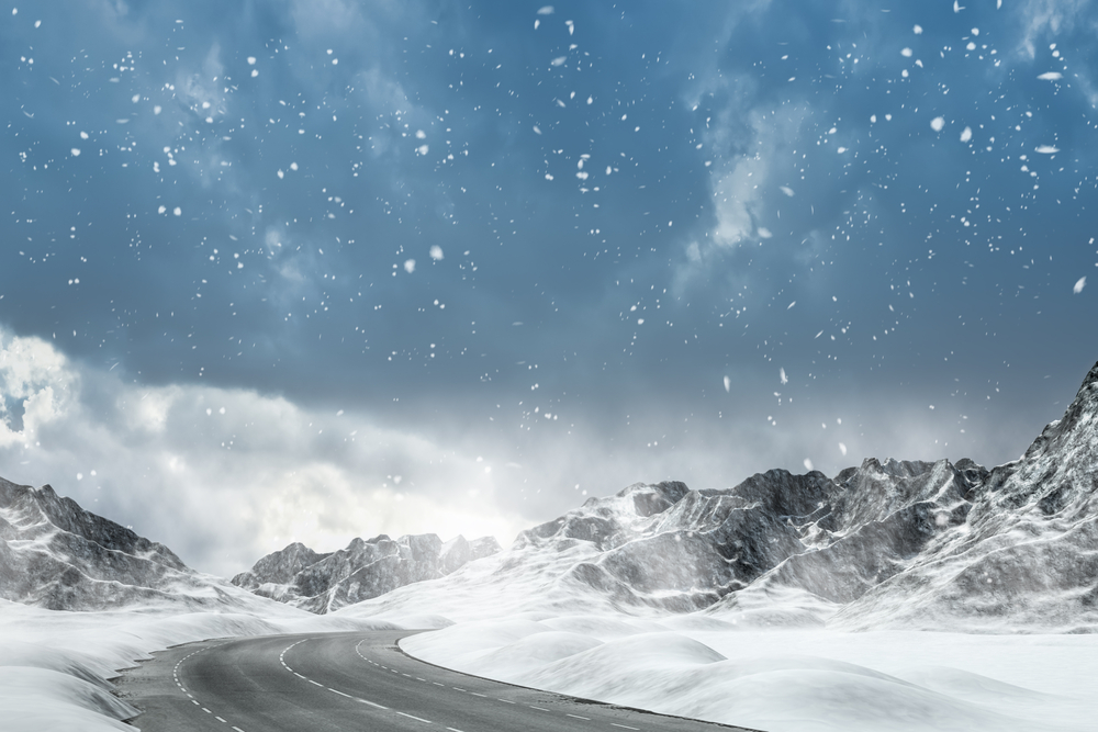 snow capped mountain with road